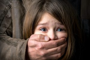 26747521 - scared young girl with an adult man's hand covering her mouth